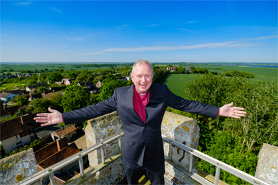 Right Reverend Roger Morris at the top of church in Peldon